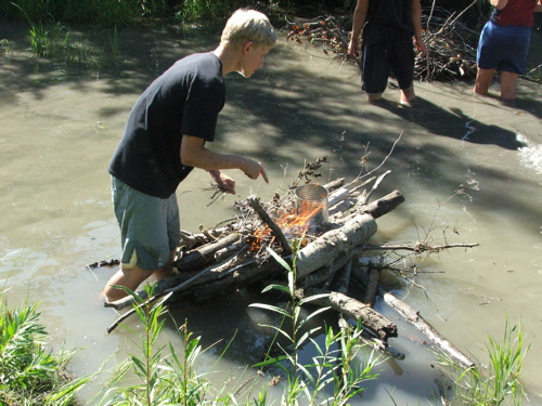 Boiling an egg in the river